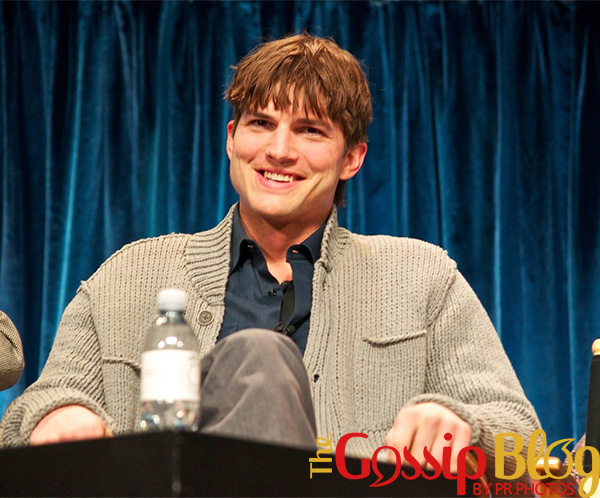 Ashton Kutcher laughing