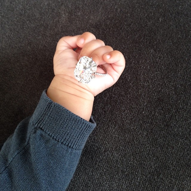 north west holding kim engagegment ring