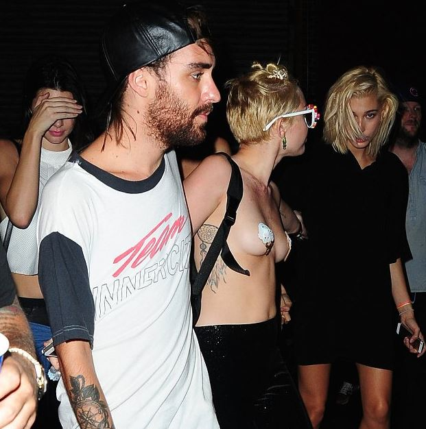 Miley Cyrus Parties Hard AND Topless with the Jenners! Check out the Candids!